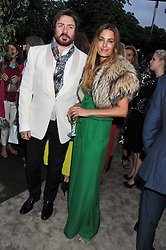 SIMON & YASMIN LE BON at the annual Serpentine Gallery Summer Party sponsored by Burberry held at the Serpentine Gallery, Kensington Gardens, London on 28th June 2011.