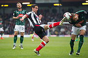 Grimsby Town Defender Danny Andrew (3) fouls Plymouth Argyle Defender Gary Sawyer (3) with high foot during the EFL Sky Bet League 2 match between Grimsby Town FC and Plymouth Argyle at Blundell Park, Grimsby, United Kingdom on 6 May 2017. Photo by Craig Zadoroznyj.