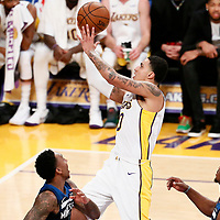 25 December 2017: Los Angeles Lakers forward Kyle Kuzma (0) goes for the layup past Minnesota Timberwolves guard Jeff Teague (0) and Minnesota Timberwolves guard Jimmy Butler (23) during the Minnesota Timberwolves 121-104 victory over the LA Lakers, at the Staples Center, Los Angeles, California, USA.