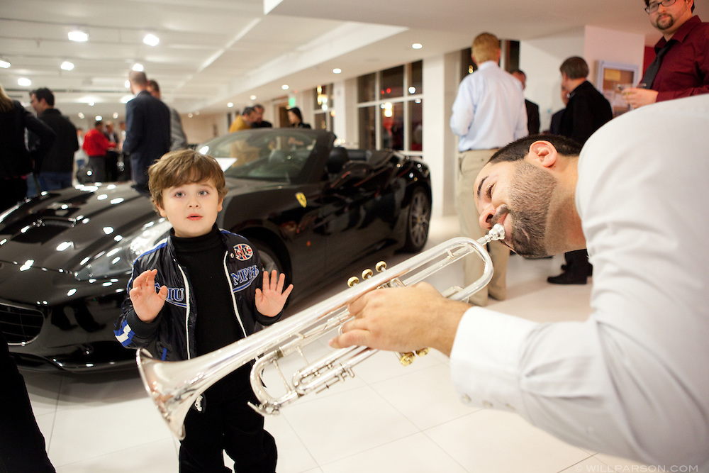 Musician Rico DeLargo demonstrates the use of his trumpet to Bobby Kline, from Bonsall.