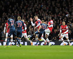Bayern Munich's Arjen Robben fires his free kick in to the Arsenal  Wall - Photo mandatory by-line: Joe Meredith/JMP - Tel: Mobile: 07966 386802 19/02/2014 - SPORT - FOOTBALL - London - Emirates Stadium - Arsenal v Bayern Munich - Champions League - Last 16 - First Leg