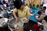 Sheep's head soup for sale in the colorful weekly market, Zumbagua, Ecuador (From a photographic gallery of street food images, in Hungry Planet: What the World Eats, p. 131)