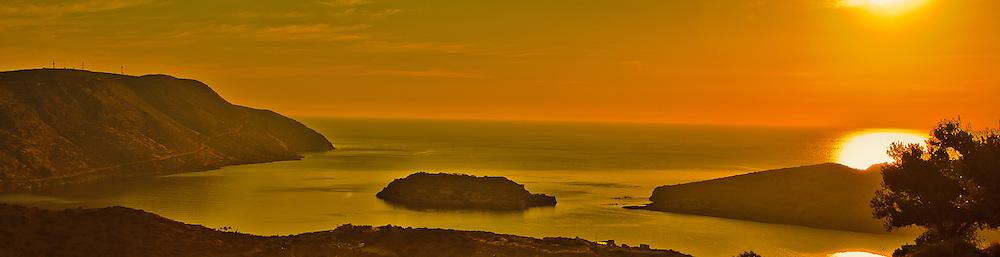 As the sun started to rise, the golden orange haze engulfed Spinalonga in Plaka, Crete Greece.