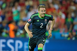 LYON, FRANCE - Wednesday, July 6, 2016: Wales' Chris Gunter in action against Portugal during the UEFA Euro 2016 Championship Semi-Final match at the Stade de Lyon. (Pic by David Rawcliffe/Propaganda)