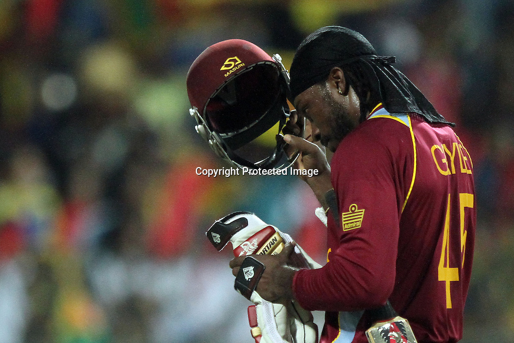 West Indies cricketer Chris Gayle walks back to the pavilion after his dismissal during the ICC World Twenty20 final between Sri Lanka and the West Indies held at the Premadasa Stadium in Colombo, Sri Lanka on the 7th October 2012.<br /> <br /> Photo by Sanka vidanagama/SPORTZPICS/PHOTOSPORT