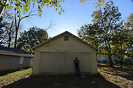 After injecting a vein with heroin, Tara--a mother of five who did not want her last name used--stands in front of the abandoned garage in the alley where she often shoots up. The alley is near the home of her young children in the South Side neighborhood of Hamilton, Ohio, an epicenter of a national heroin epidemic. In the first moments after shooting up, she says she feels numb.