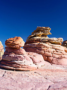 Photograph of the beautiful geology and wild rock formations at South Coyote Buttes, Vermilion Cliffs National Monument, Arizona, USA.