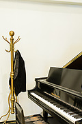 Leonard Bernstein's brass coatrack and Baldwin baby grand piano, from his Fairfield, Connecticut home and studio.