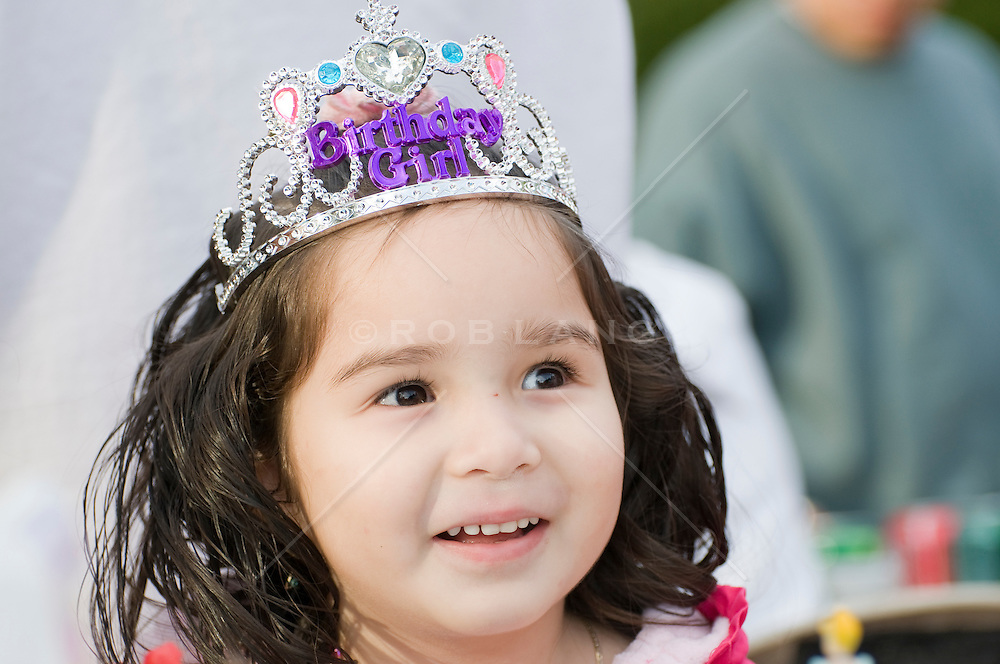 Young latin girl wearing a princess birthday tiara