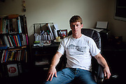 Ross Caputi, 27, is sitting in his living room in.Lunenburg, MA, USA, near Boston, where just completed a course in linguistics from Boston University. He shares his home with his wife Dahlia Wasfi, 40, whose father is Iraqi. Ross was a radio operator for his company in Fallujah in 2004, during the battles. After leaving the Marines, he turned to anti-war activism. Ross runs a project called 'Justice for Fallujah', which aims at raising awareness about the problems in Fallujah since the 2004 US-led battles, and about the wrongs of war, after having witnessed them first-person as a soldier in Iraq.