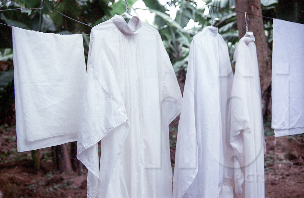 Clothesline of cassocks drying outside a church in Nam Dinh province, Vietnam, Asia