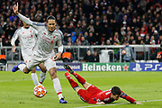Liverpool defender Virgil van Dijk (4) and Bayern Munich forward Robert Lewandowski (9) clash but no foul is given during the Champions League match between Bayern Munich and Liverpool at the Allianz Arena, Munich, Germany, on 13 March 2019.