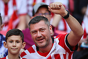 A Southampton fan with his young son during the The FA Cup match between Chelsea and Southampton at Wembley Stadium, London, England on 22 April 2018. Picture by Toyin Oshodi.