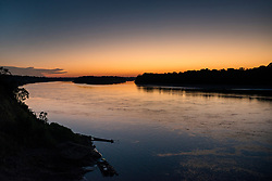 NO WEB/NO APPS - Exclusive. (Text available) View of a sunset over the Madre de Dios river seen from the 'Palma Real' native community, near Puerto Maldonado, Peru on July 17, 2017. The Amazon rainforest is famous as 'The Lung of the Earth', but also for the presence of numerous native communities, who have always lived isolated and in close contact with nature for generations, used to seek for food and medicines and to build items directly from the environment in which they live. The unstoppable rise of globalization has drastically changed their needs, expectations and consequently their way of life. Located in the Tambopata National Reserve, on the border between Peru and Bolivia, the native Comunidad Palma Real is one of the clearest examples of this change. Living on the banks of the Madre de Dios River since approximately 1976, Palma Real comprises about 300 people part of the nomadic community Ese-Eja, established in the Amazon rainforest of Peru before the Spanish colonization. Photo by Giacomo d'Orlando/ABACAPRESS.COM