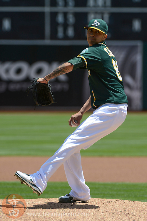 May 29, 2014; Oakland, CA, USA; Oakland Athletics starting pitcher Jesse Chavez (60) delivers a pitch against the Detroit Tigers during the first inning at O.co Coliseum.