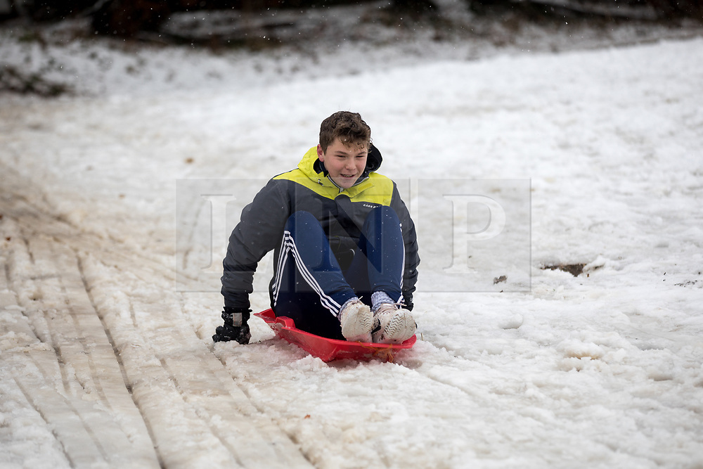 © Licensed to London News Pictures. 11/12/2017. Amersham, UK. Elliot from Amersham plays in the snow in Amersham. Yesterday parts of the south east of England experienced heavy snow, with the home counties experiencing some of the worst conditions. Many schools in the area are closed today. Photo credit : Tom Nicholson/LNP