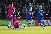 Southend United midfielder Anthony Wordsworth (4) battles for possession with AFC Wimbledon midfielder Jake Reeves (8) during the EFL Sky Bet League 1 match between AFC Wimbledon and Southend United at the Cherry Red Records Stadium, Kingston, England on 25 March 2017. Photo by Matthew Redman.