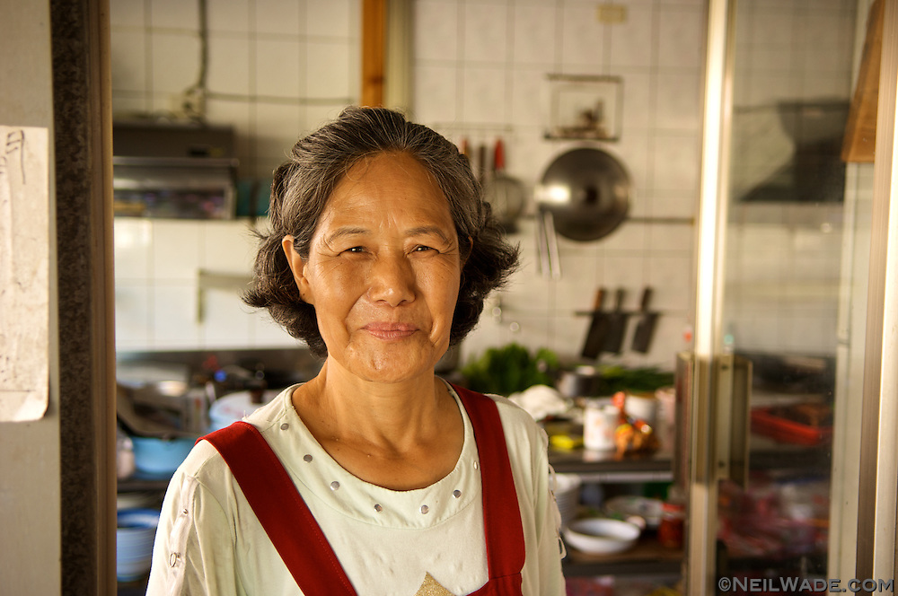 A warm smile from a Taiwanese woman in rural Taiwan.