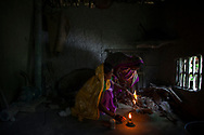 Gauri Moanda, 48,  uses a wood burning stove in her kitchen at her organic farm in village in Indroprastha, West Bengal, India Thursday, Oct. 4, 2012 (Photo/Elizabeth Dalziel for Christian Aid)