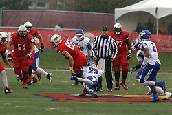 31 October 2015:  Lonnell Brown Jr.(25) makes a lunge to stop runner Tylor Petkovich(85) during the NCAA FCS Football between Indiana State Sycamores and Illinois State Redbirds at Hancock Stadium in Normal IL (Photo by Alan Look)