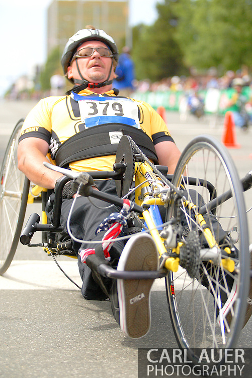 July 4th, 2006:  Anchorage, Alaska - William Smith (379), a Army veteran from Modesto, California, catches his breath after completing the 5k handcycle event at the 26th National Veterans Wheelchair Games..