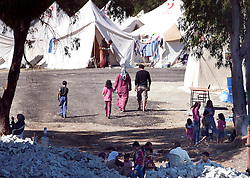 © licensed to London News Pictures. HATAY/ TURKEY. PICTURE DATED. 17/06/2011. A Syrian refugee family at the Turkish Red Crescent camp in the Yayladagi district of the Turkish city of Hatay, two kilometers from the Syrian border, on June 17, 2011. More than 9.000 Syrians have now fled the violence of Syria's 3-month anti-regime uprising against the rule of President Bashar al-Assad and crossed into Turkey in the past ten days. Please see special instructions for usage rates. Photo credit should read TOLGA AKMEN/LNP