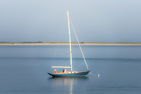 Sailboat at dusk in Aunt Lydias Cove, in Chatham, Massachusetts, U.S.A.