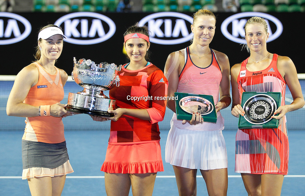 29.01.2016. Melbourne Park, Melbourne, Australia. Austalian Open Tennis Championship. Mens Semi Final Day. Marina Hingis and Sania Mirza celebrate with their trophies after winning the ladies doubles against Czechs Andrea Hlavackova  and Lucie Hradecka