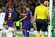 LUIS SUAREZ of FC Barcelona smiles and celebrates while KOSTAS MANOLAS of AS Roma (sit down) looks dejected after scoring an own goal during the UEFA Champions League, quarter final, 1st leg football match between FC Barcelona and AS Roma on April 4, 2018 at Camp Nou stadium in Barcelona, Spain - Photo Manuel Blondeau / AOP Press / ProSportsImages / DPPI
