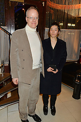 HANS ULRICH OBRIST and KOO JEONG A at a dinner to celebrate the publication of Obsessive Creative by Collette Dinnigan hosted by Charlotte Stockdale and Marc Newson held at Mr Chow, Knightsbridge, London on 9th February 2015.