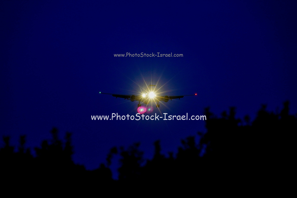 Silhouette of a commercial passenger plane landing at night Photographed on Cephalonia, Ionian Islands, Greece