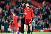 Liverpool Manager Jurgen Klopp \gives Liverpool midfielder Adam Lallana (20) his pep talk before the Premier League match between Liverpool and Everton at Anfield, Liverpool, England on 4 December 2019.