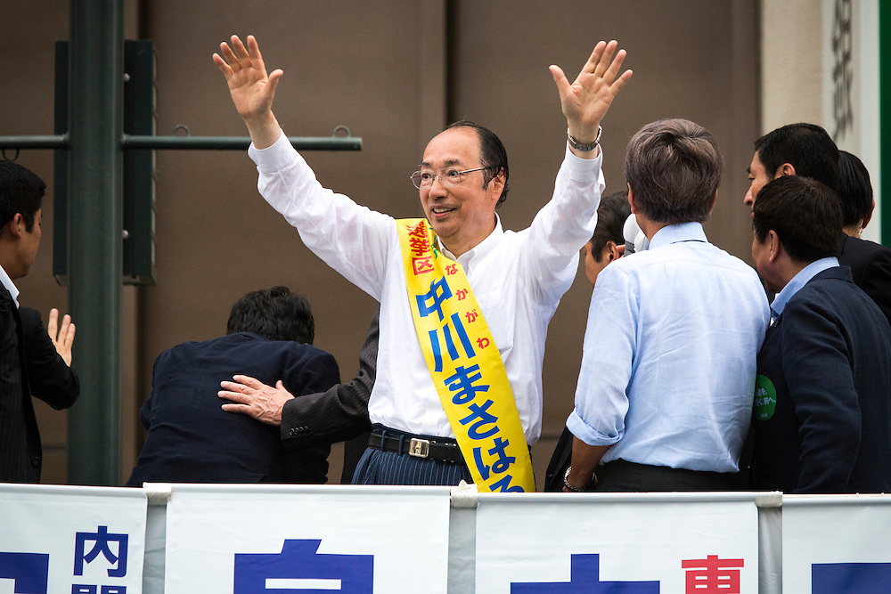 TOKYO, JAPAN - JULY 9 :  Masaharu Nakagawa a candidate from Liberal Democratic Party (LDP) greets supporters during the last day of 2016 Upper House election campaign outside of Asakusa Station in Tokyo, Japan on July 9, 2016. Tomorrow, July 10, 2016 will be the first Upper house election nation-wide in Japan that 18 years old can vote after Japanese government law changes its voting age from 20 years old to 18 years old. (Photo by Richard Atrero de Guzman/NURPhoto)