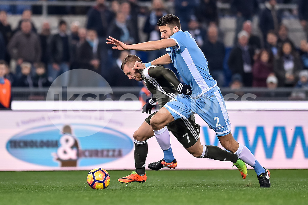 Gerard Deulofeu of AC Milan and Wesley Hoedt of Lazio during the Serie A match between Lazio and AC Milan at Stadio Olimpico, Rome, Italy on 13 February 2017. Photo by Giuseppe Maffia.