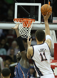 Apr 11; Newark, NJ, USA; New Jersey Nets center Brook Lopez (11) makes a basket during the second half at the Prudential Center. The Bobcats defeated the Nets 105-103.