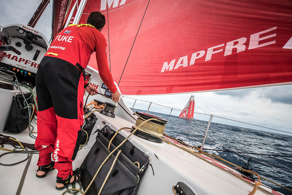 Leg 6 to Auckland, day 02 on board MAPFRE, Blair Trimming a sail with Dongfeng in leeward. 08 February, 2018.