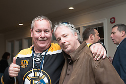 Mike Devine, loyally sporting his Bruins' shirt, was one of the principal organizers of the event.