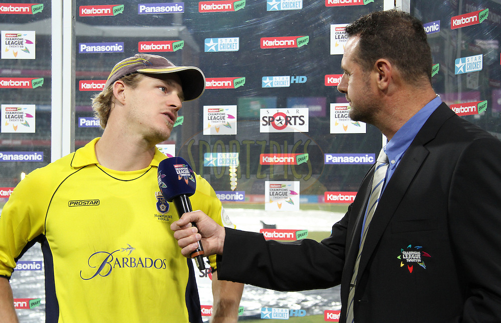 James Adams of Hampshire Royals is interviewed by commentator Simon Doull during the 6th Qualifying match of the Karbonn Smart CLT20 South Africa between Hampshire and Sailkot Stallions held at The Wanderers Stadium in Johannesburg, South Africa on the 11th October 2012..Photo by Shaun Roy/SPORTZPICS/CLT20
