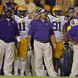 Oct 10, 2009; Baton Rouge, LA, USA; LSU Tigers defensive coordinator John Chavis (center) on the sideline during a game against the Florida Gators at Tiger Stadium. Florida defeated LSU 13-3. Mandatory Credit: Derick E. Hingle-US PRESSWIRE