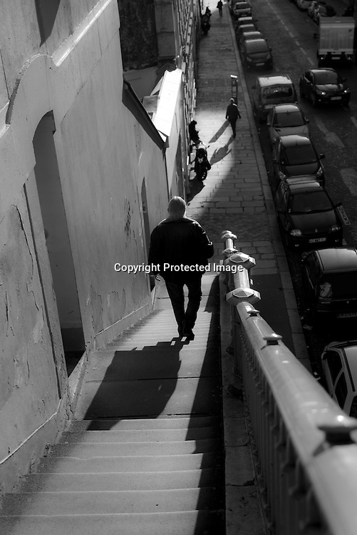 Paris 8th. stairway going to an elevated street in ,Rue Portalis