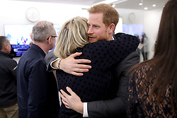 February 28, 2018 - London, London, United Kingdom - Image licensed to i-Images Picture Agency. 28/02/2018. London, United Kingdom.The Duke and Duchess of Cambridge, Prince Harry and Meghan Markle meet with panelists and beneficiaries at the first Royal Foundation Forum in London. Under the theme ÔMaking a Difference Together,Ã• the event  showcased the programmes run or initiated by The Royal Foundation. Pic shows: Prince Harry hugs journalist Bryony Gordon. (Credit Image: © Rota/i-Images via ZUMA Press)