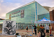 Garden City, New York, USA. 14th September 2014. The United Ink Flight 914 tattoo convention has live tattooing by famous artists, contests, outdoor suspension shows, and more at the Cradle of Aviation museum of Long Island. At left is a mural of the Grim Reaper by graffiti artist DAN AZACETA, aka JOUST201, from New Jersey.