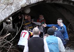 The ball ends up in the River Dove - Mandatory byline: Robbie Stephenson/JMP - 09/02/2016 - FOOTBALL -  - Ashbourne, England - Up'Ards v Down'Ards - Royal Shrovetide Football
