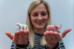 © Licensed to London News Pictures. 08/04/2016. London, UK. Ceramicist Charlotte Pack shows miniatures inspired by endangered animals. The leading international fair for contemporary ceramics, Ceramic Art London 2016, opens at its new venue of Central Saint Martins, King's Cross.  88 emerging and established ceramicists from around the world are presenting and their latest works for sale to the public with prices ranging from £30 to £10,000. Photo credit : Stephen Chung/LNP
