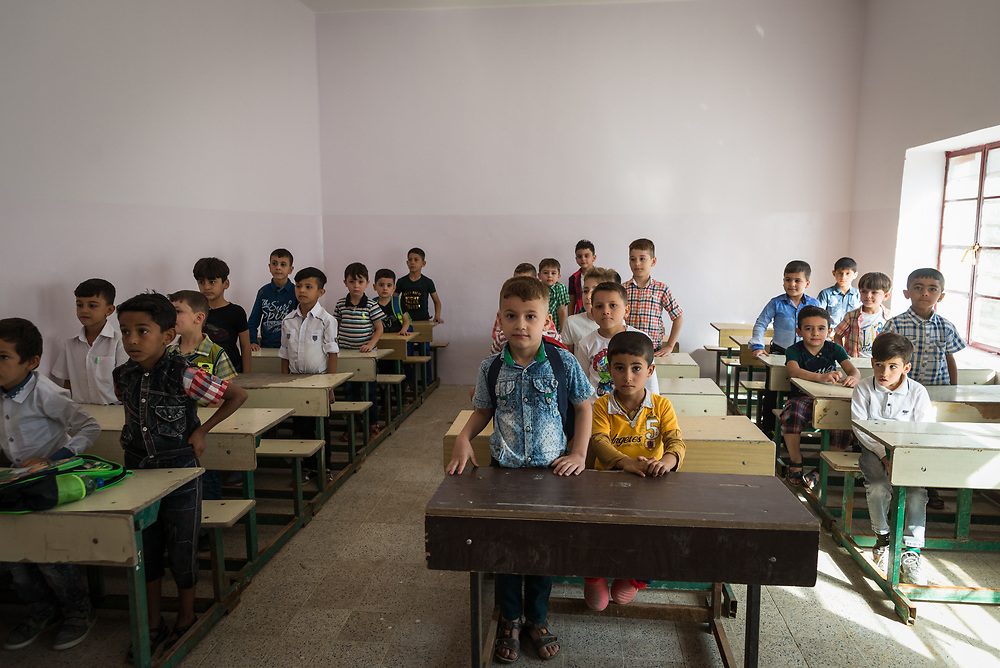 11 October 2017 &ndash; Ninewa Plains &ndash; Iraq &ndash; A class in session at Al-Taghllubia School for Boys in the Ninewa Plains on the day the school reopened its doors to pupils after being closed for 3 years. <br /> <br /> &ldquo;There was no one here for 3 years after ISIL came,&rdquo; said Principal Jubrail Ibrahim. &ldquo;The students went to Erbil, Duhok, Baghdad, Kirkuk. Today is the first day the pupils came back to their school. It&rsquo;s made us all very happy.&rdquo; UNDP&rsquo;s Funding Facility for Stabilization is helping rehabilitate the school. <br /> <br /> &copy; UNDP Iraq / Claire Thomas