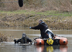 police divers remove material during a search of a section of the Monklands Canal at Carnbroe by Police Scotland's underwater search unit in the search for the remains of 11-year-old Moira Anderson, who disapeared in 1957 and is widely believed to have been abducted and murdered by convicted paedophile Alexander Gartshore. <br /> © Dave Johnston/ EEm