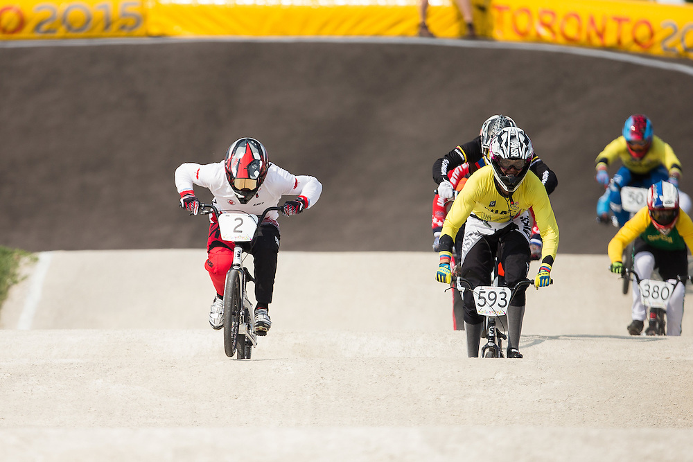 Canada's Tory Nyhaug rides to victory in the BMX at the 2015 Pan American Games in Toronto, Canada July 11,  2015.  AFP PHOTO/GEOFF ROBINS