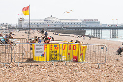 © Licensed to London News Pictures. 26/07/2020. Brighton, UK. Members of the public take to the beach in Brighton And Hove as sunny weather hits the seaside resort. Photo credit: Hugo Michiels/LNP