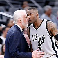 02 April 2017: San Antonio Spurs head coach Gregg Popovich talks to San Antonio Spurs guard Jonathon Simmons (17) during the San Antonio Spurs 109-103 victory over the Utah Jazz, at the AT&T Center, San Antonio, Texas, USA.