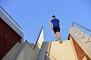 Nederland, Nijmegen, 6-3-2014Op een stenen trap omhoog, loopt een man hard. Foto: Flip Franssen/Hollandse Hoogte